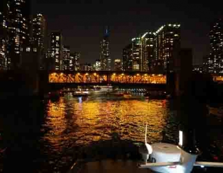 Chicago private yacht charters for moonlight cruises along Chicago lakefront late at night