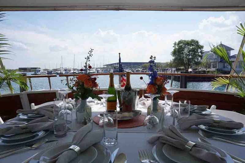 Chicago Private Yacht Rentals dining on private yacht